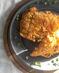 Fried chicke on a plate with sun beams