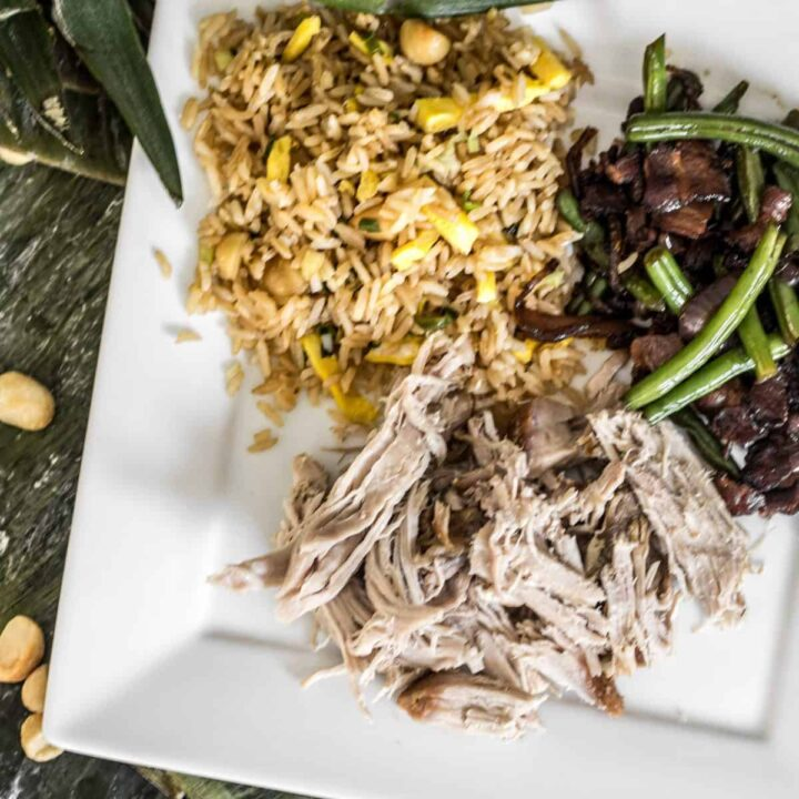 Plate of pulled pork fried rice and ohana green beans