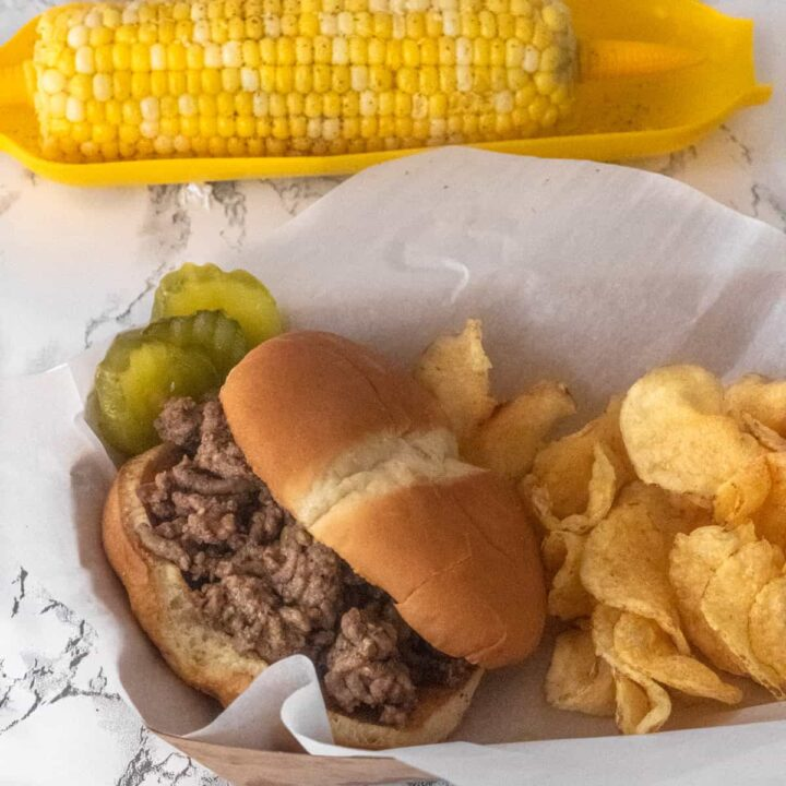 Famous food from Iowa, Loose Meat Sandwiches in a Basket with Chips, corn above