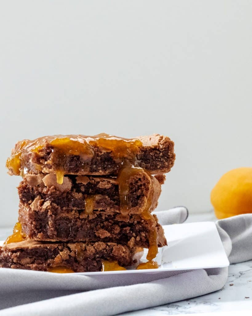 Stack of brownies with apricot glaze