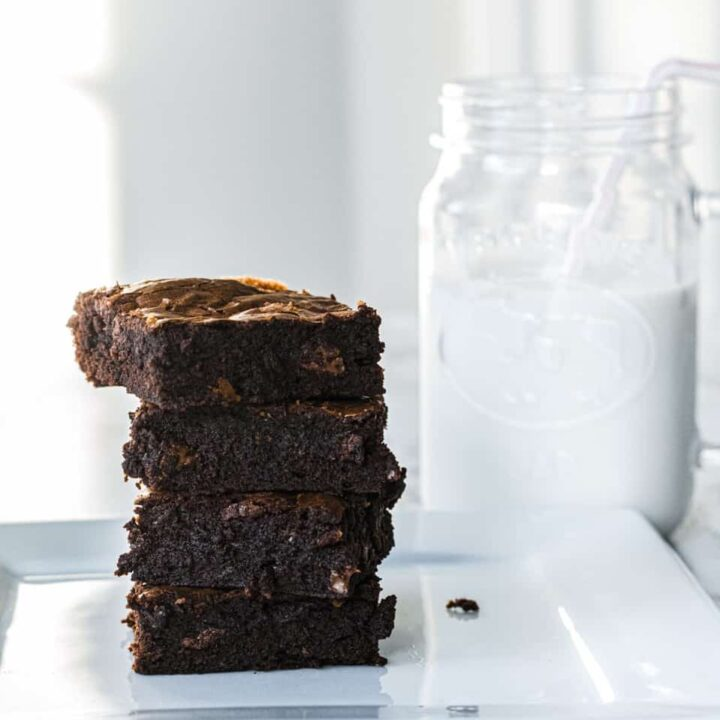 Stack of brownies and glass of milk