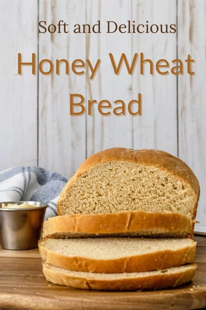 "Pinterest image of bread with 3 slices laying over, and the words ""soft and delicious honey wheat bread"" written."