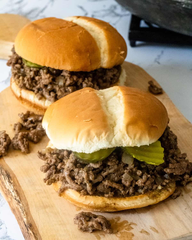 Famous food from Iowa 2 loosemeat sandwiches on a wooden board