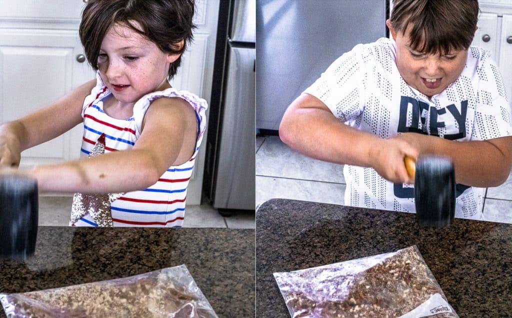 Girl and Boy Smashing Pretzels with a Mallet.