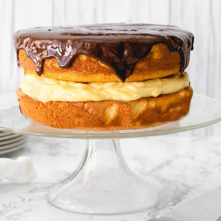 One wholeEasy Boston Cream Pie recipe on a cake plate.