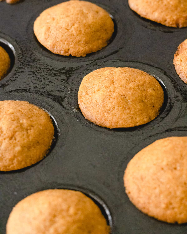 Mini muffins in a pan.
