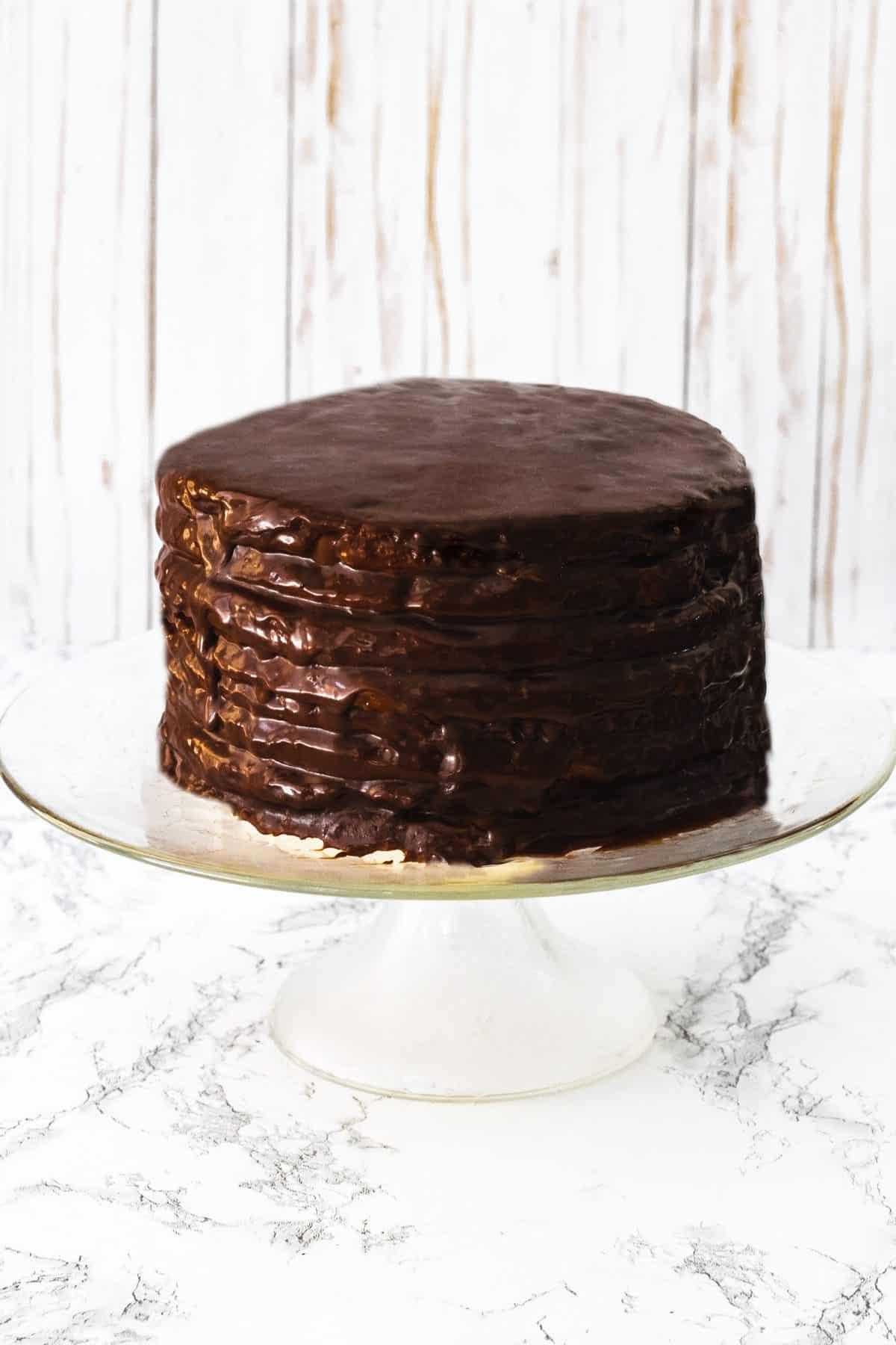 Whole Smith Island Cake on a cake stand.