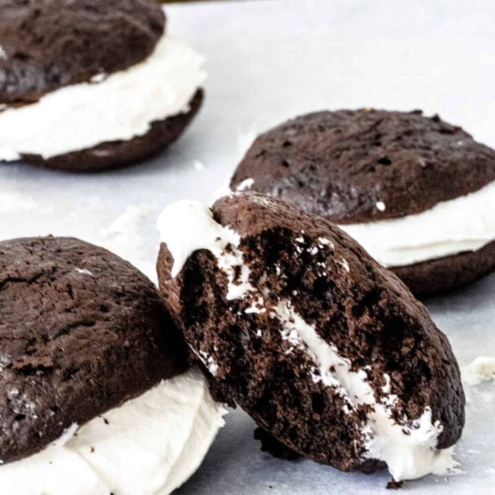 Four Maine Whoopie Pies. One is on its side and has a bite out of it.