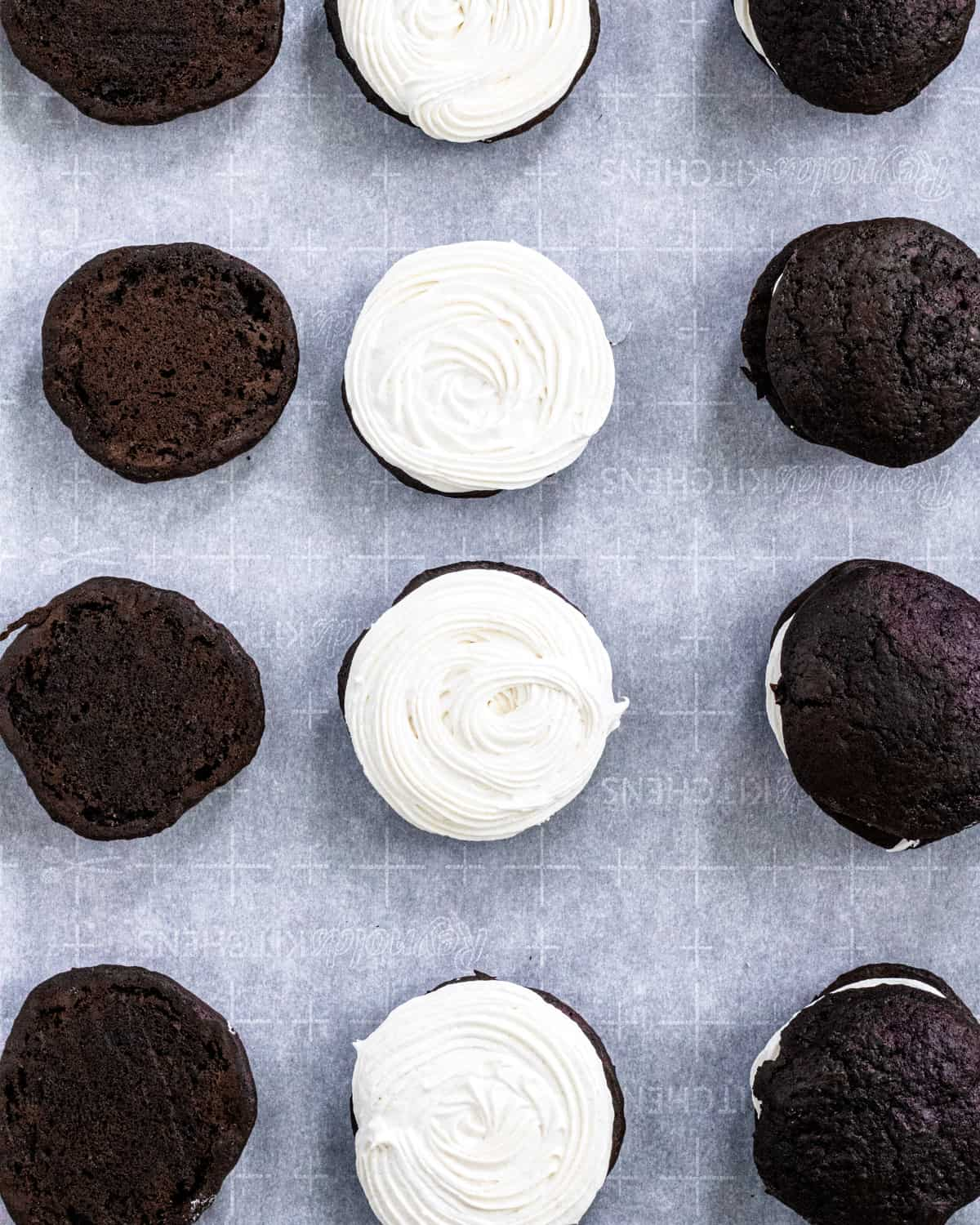 Rows of Maine Whoopie Pies: one row of tops, one row with filling, one row whole.