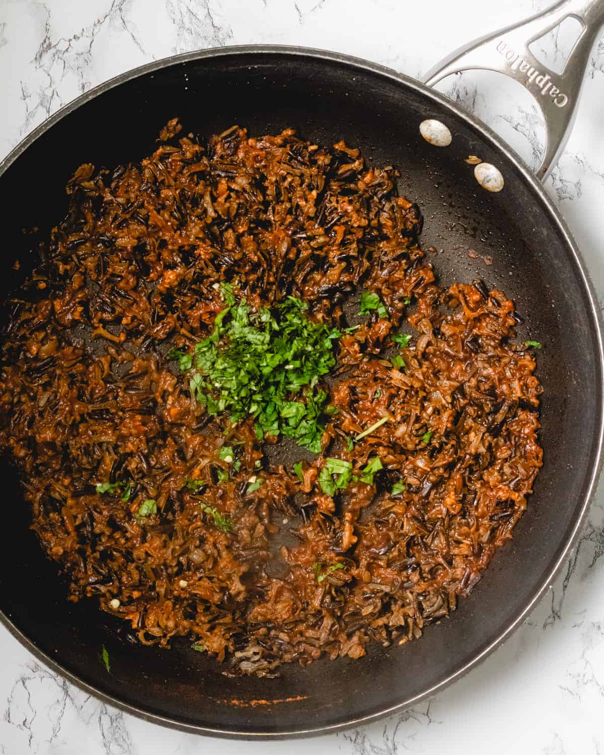 Pan of cooked Mexican wild rice with cilantro.