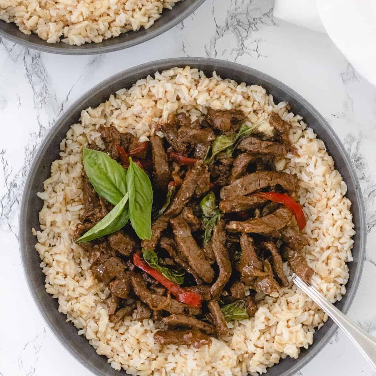Whole30 Menu Plan Week 2: Bowl of thai basil beef with brown rice.