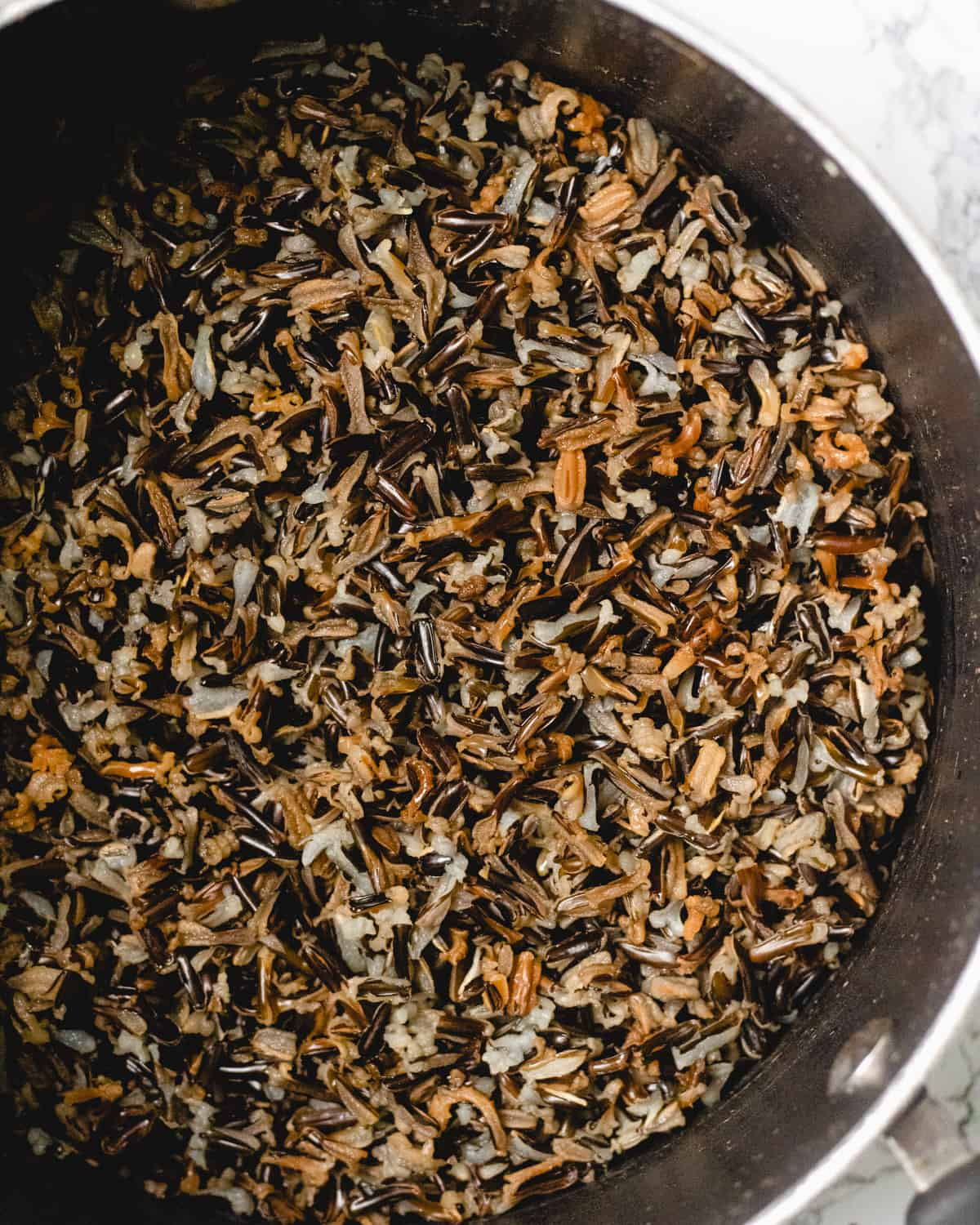 Pot of wild rice, ready to add water and boil.