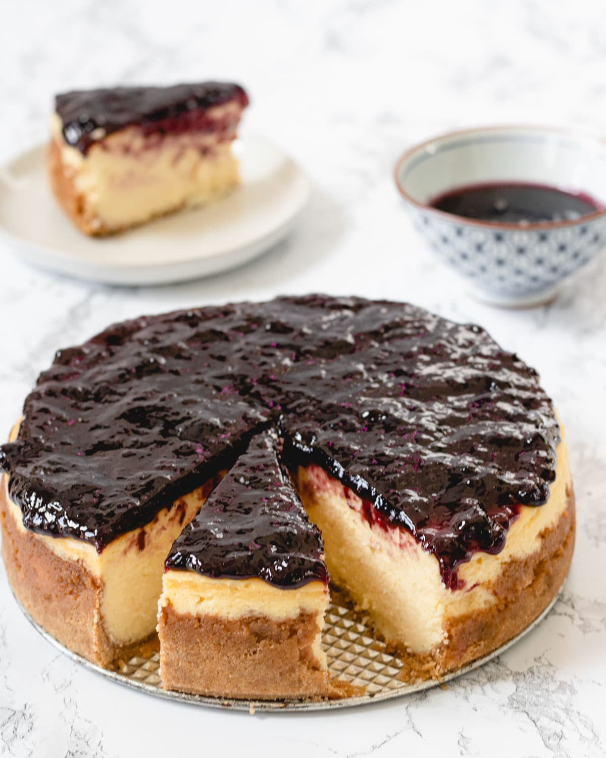 Huckleberry cheesecake with a slice offset.