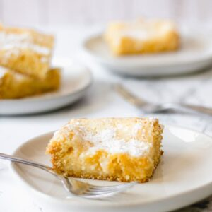 Slices of gooey butter cake on plates.