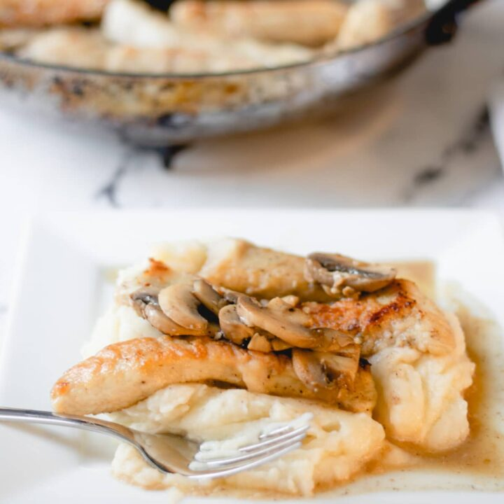 Chicken medallions and mushrooms, in a wine sauce, over mashed potatoes.