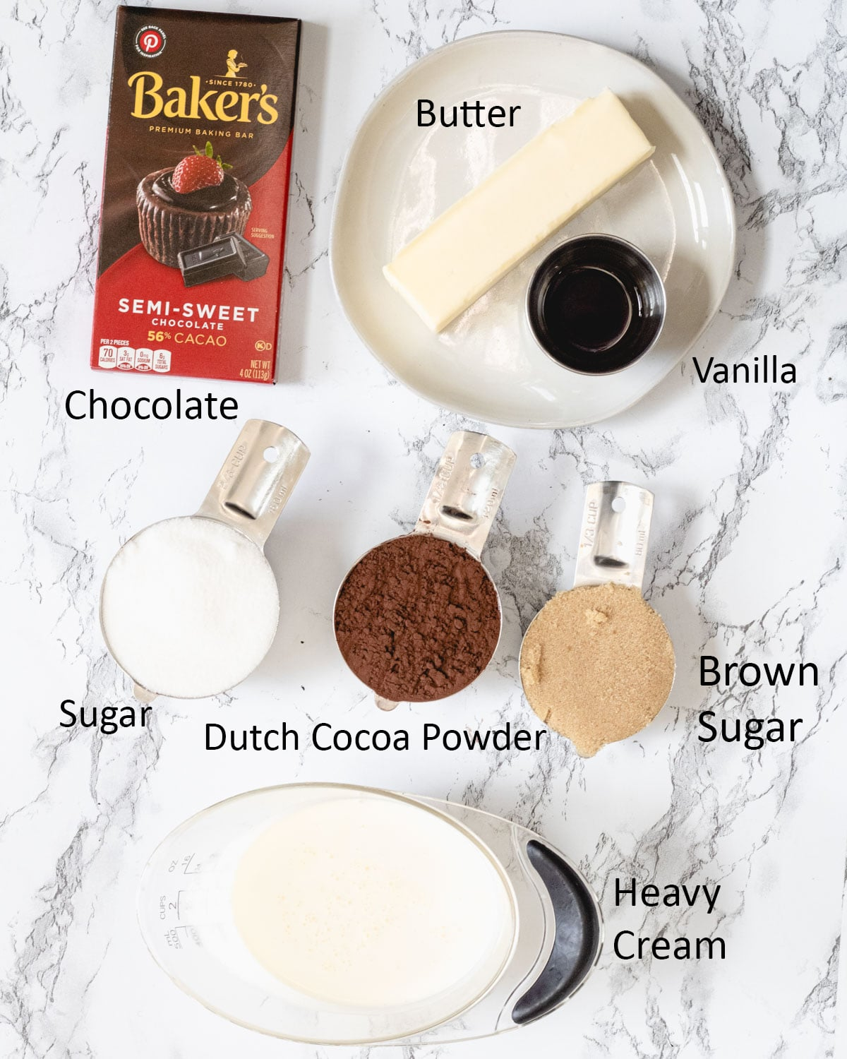 Hot fudge ingredients: Semi-sweet chocolate, butter, vanilla extraqct, sugar, Dutch cocoa powder, brown sugar, and heavy cream.