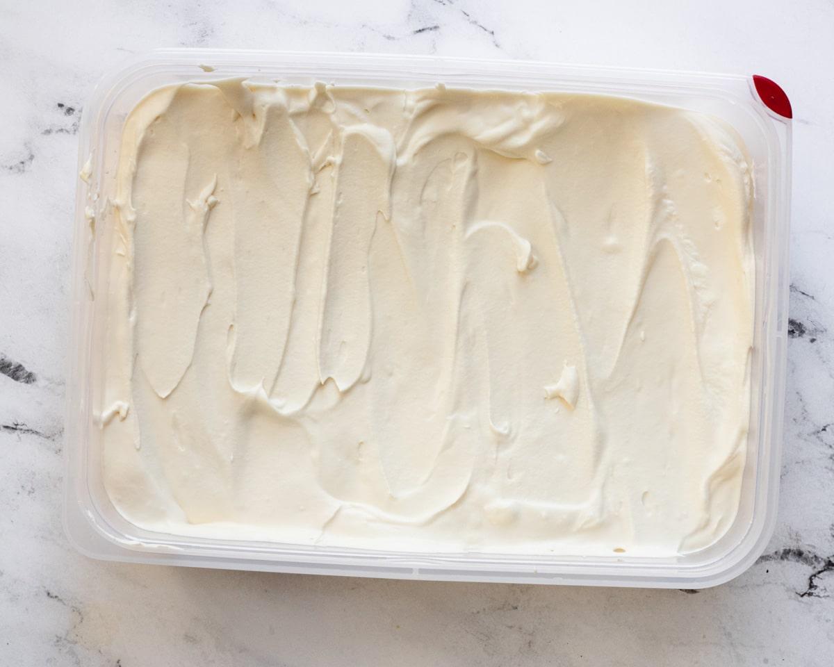 Vanilla ice cream in a freezer-safe container.
