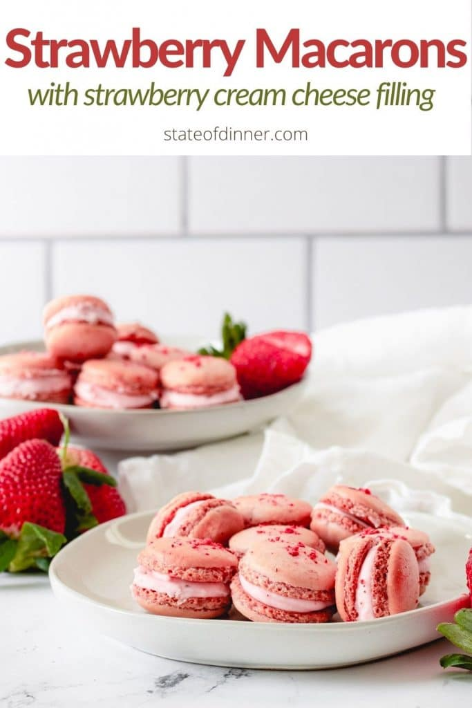 pinterest pin: two plates of strawberry macarons with strawberry cream cheese filling.