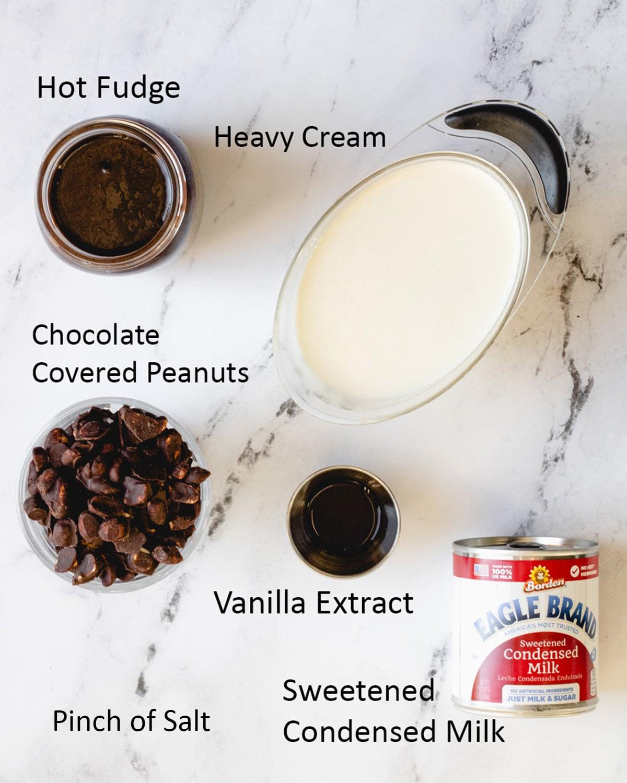 Tin Roof Ice Cream Ingredients: heavy cream, sweetened condensed milk, vanilla extract, salt, fudge sauce, and chocolate covered peanuts.