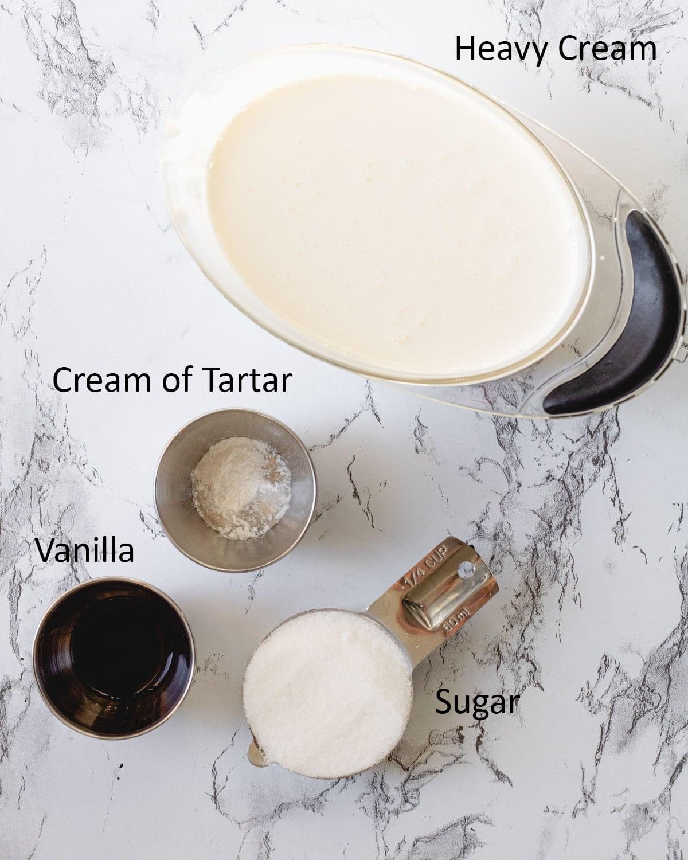 Stabilized Whipped Cream ingredients: heavy cream, cream of tartar, vanilla, and sugar