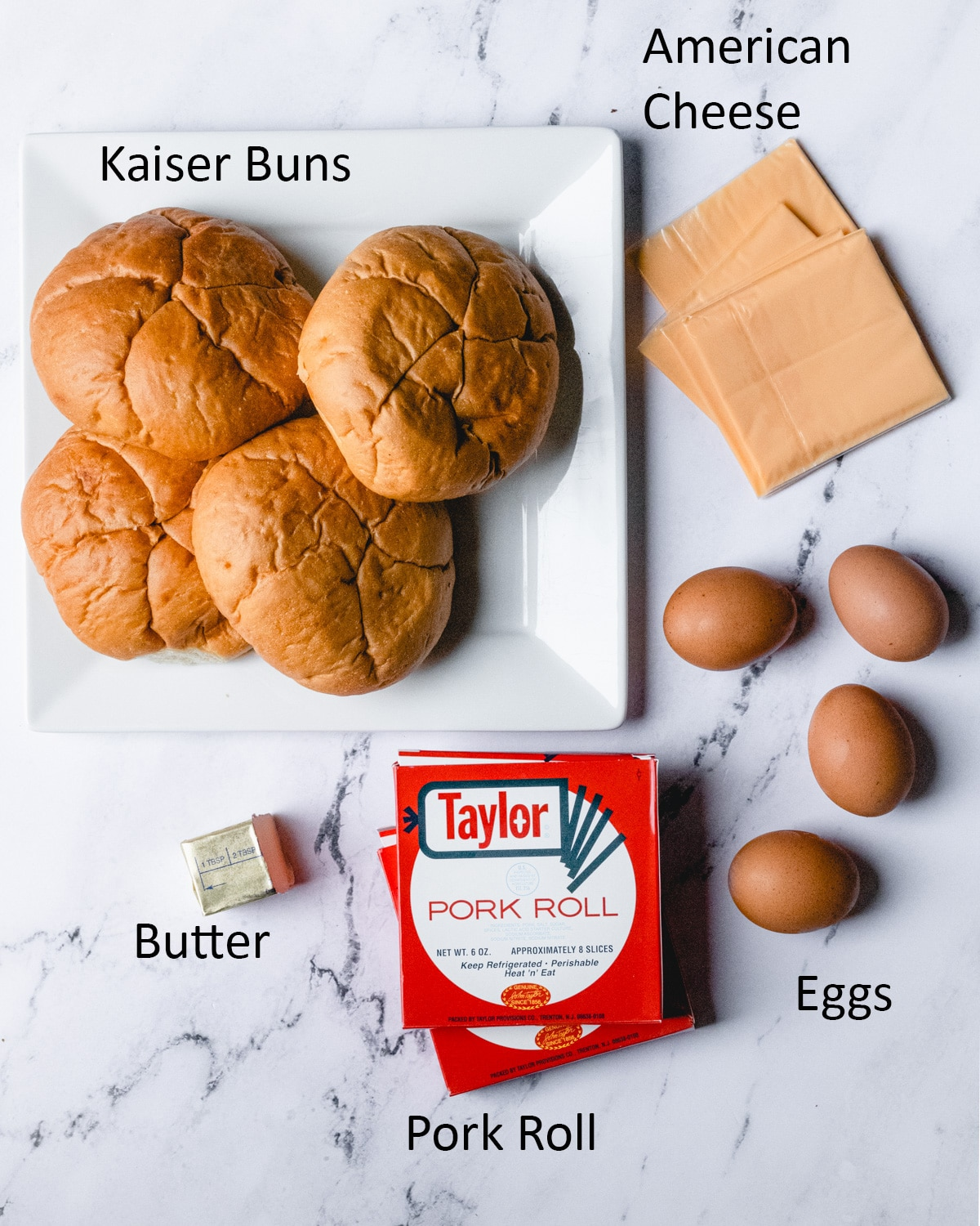 Pork roll egg and cheese sandwich ingredients: Kaiser bun, American cheese, eggs, Pork roll, and butter.