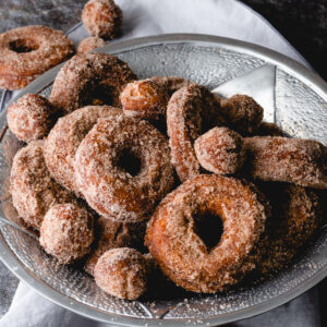 A bowl of apple cider donuts and donut holes.