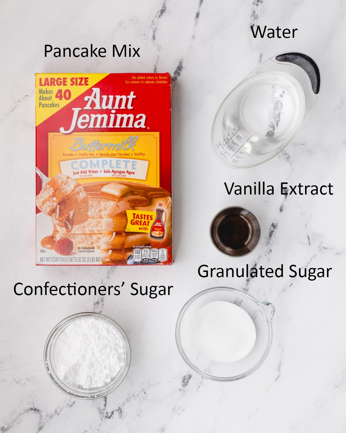 Ingredients for funnel cake bites: pancake mix, water, vanilla extract, granulated sugar, confectioners' sugar