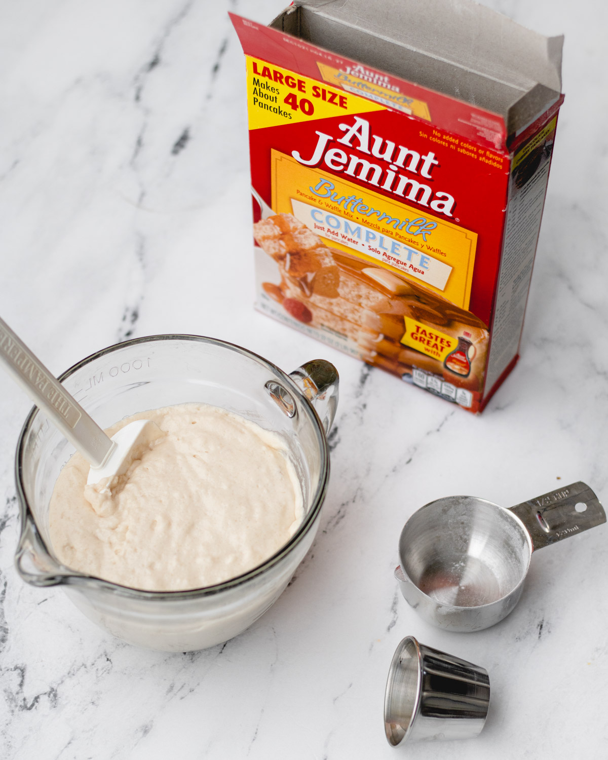 Mixing batter for funnel cakes.