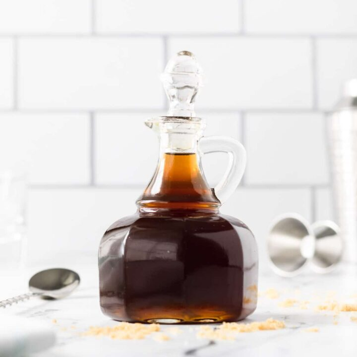 A glass bottle of brown sugar simple syrup.