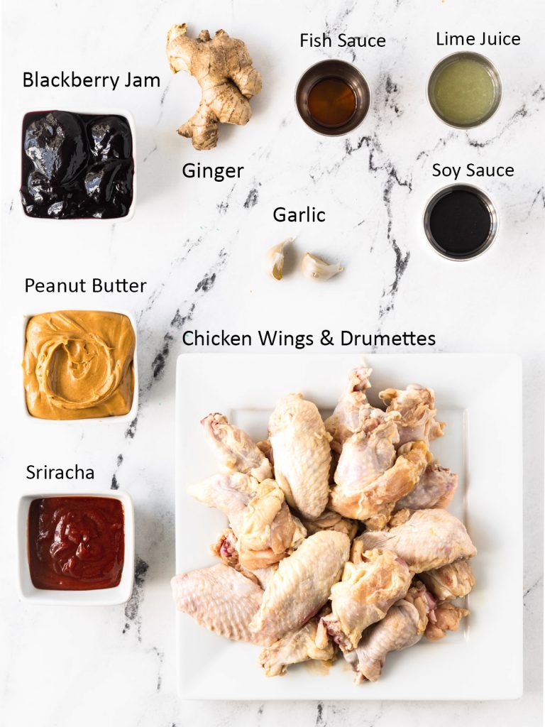 PB&J Wings ingredients: blackberry jam, peanut butter, sriracha, chicken wings & drumettes, ginger, garlic, fish sauce, lime juice, and soy sauce.