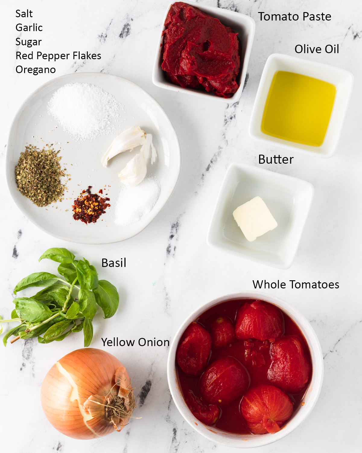 Ingredients for New York-Style Pizza Sauce: Tomato Paste, olive oil, butter, whole tomatoes, basil, yellow onion, salt, garlic, sugar, red pepper flakes, and Oregano.