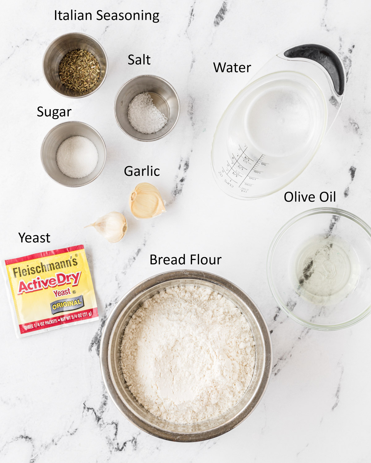 Labeled photo of garlic and herb pizza dough ingredients