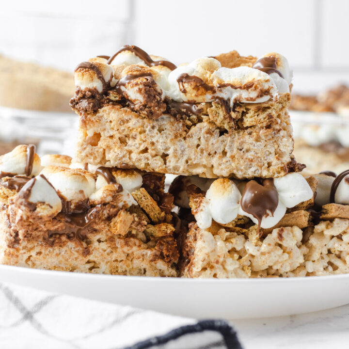 3 s'mores rice krispie treats on a white plate.