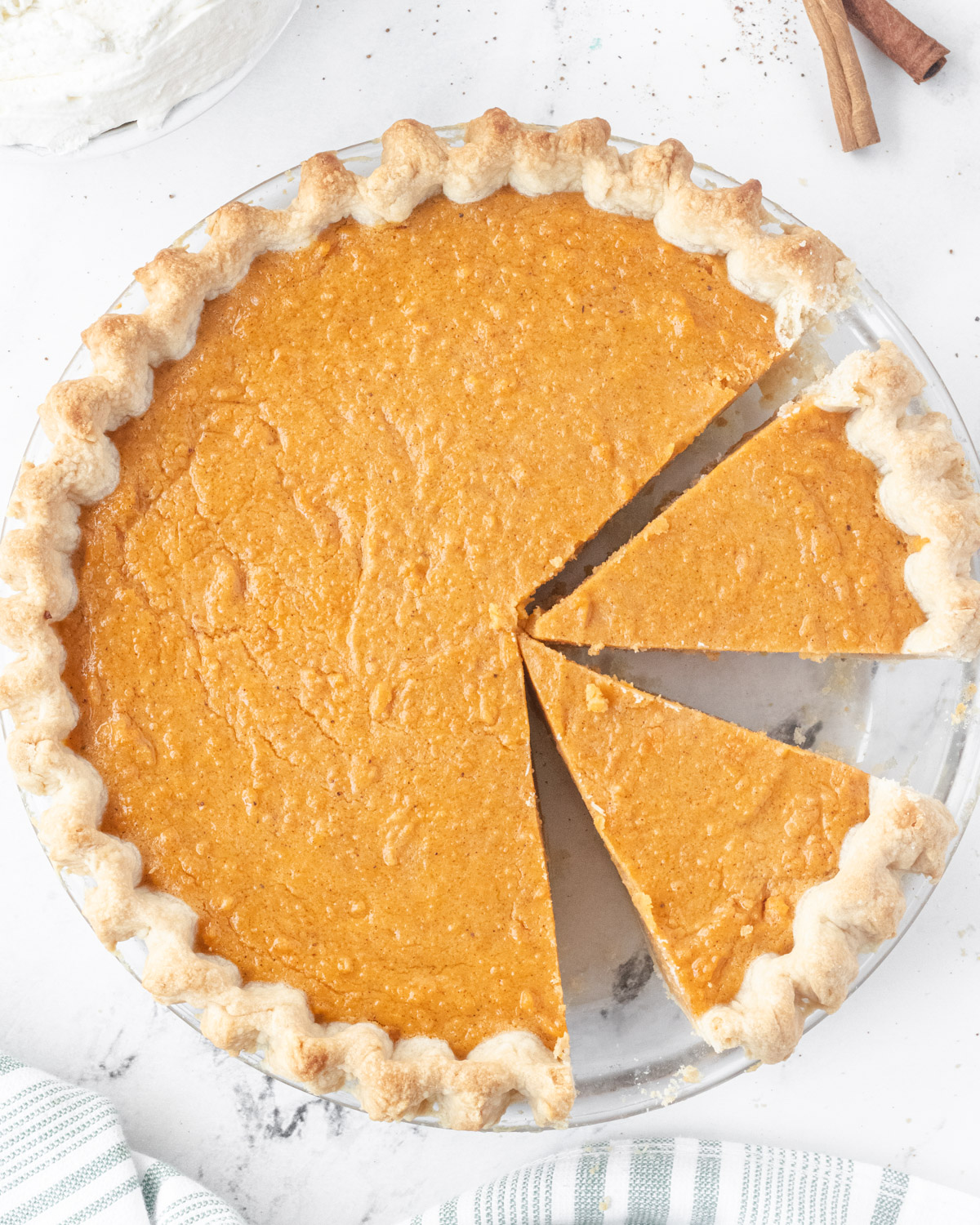 Overhead view of sweet potato pie with two pieces sliced.