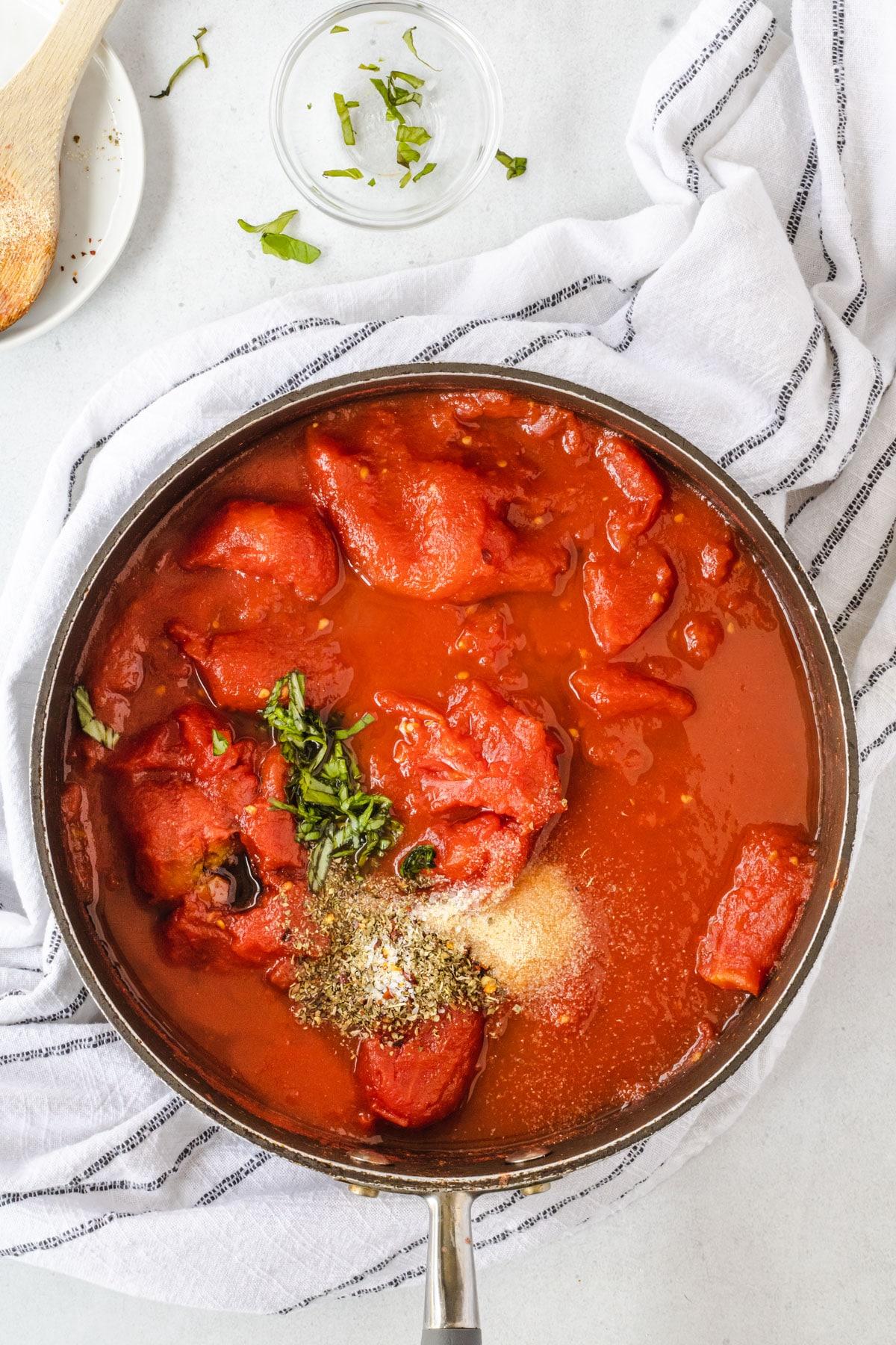 Hearty marinara sauce ingredienets in pan.