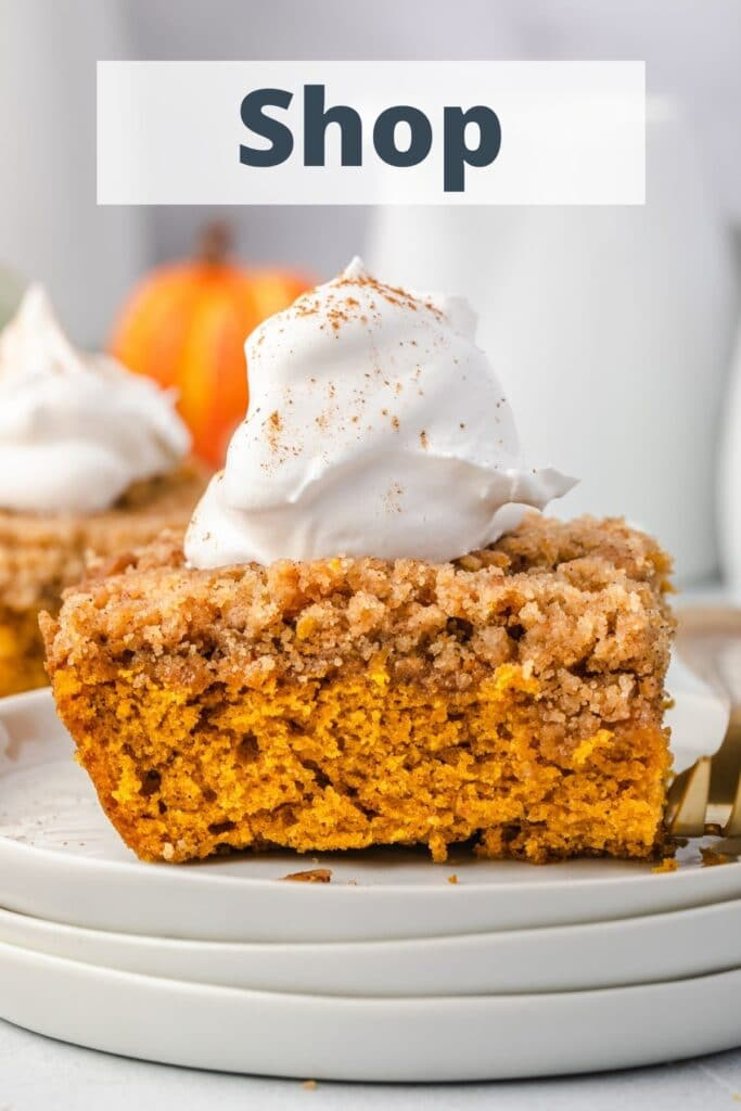 """Pumpkin coffee cake with whipped cream, and the words """"shop"""" at the top."""