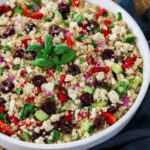 Close up of Mediterranean Quinoa Salad with olives and red peppers.