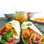 Paneer kathi rolls wtih jar of mango chutney.